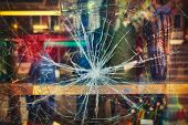 foto of gun shop  - Broken shop window with color background - JPG