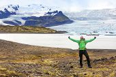 stock photo of cheers  - Hiking adventure travel man cheering happy on hike on Iceland - JPG
