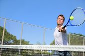 image of balls  - Tennis player man hitting ball in a volley - JPG