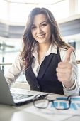 picture of thumb  - Portrait young business woman working in a modern office - JPG