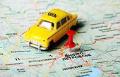 image of dnepropetrovsk  - Close up of Dnepropetrovsk Ukraine map with red pin and a taxi toy - JPG