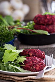 picture of veggie burger  - Beet root and red bean vegan burgers with salad - JPG