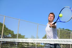picture of balls  - Tennis player man hitting ball in a volley - JPG
