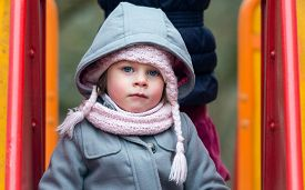 stock photo of chute  - Cute Little Girl with big blue eyes looking at camera  - JPG