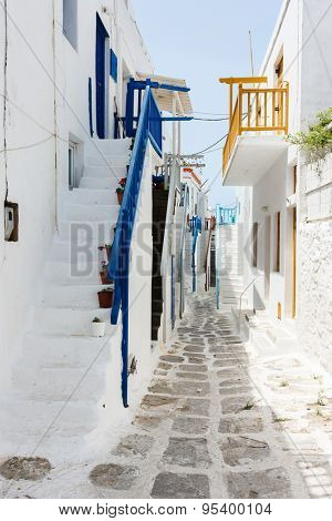 Typical greek traditional village with white walls and colorful doors, windows and balconies on Mykonos Island, Greece, Europe