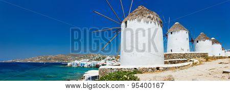 Panorama of white greek windmills overlooking Little Venice popular tourist destination at traditional village on Mykonos Island, Greece, Europe