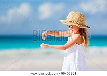 Adorable little girl at tropical beach during summer vacation