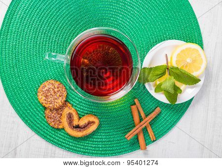 Cup of tea with mint, cinnamon and lemon.