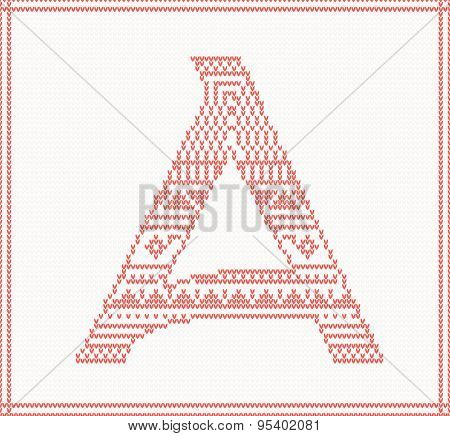Red knitted Letter A with ornament on beige Background