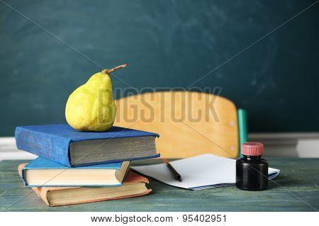 Teachers workplace  on blackboard background