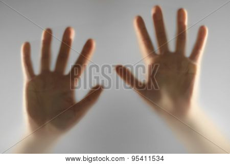 Hands silhouettes behind glass foreground