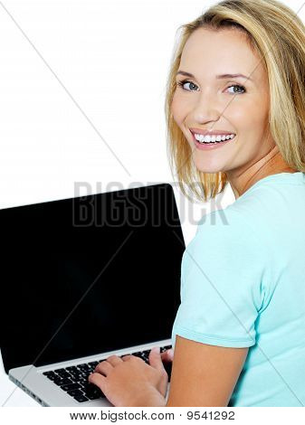 Young Woman Typing  On The Laptop
