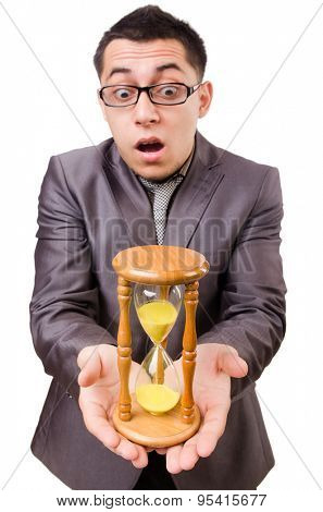 Young man with sandglass isolated on white