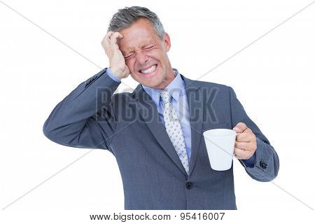businessman drinking cup of coffee before work