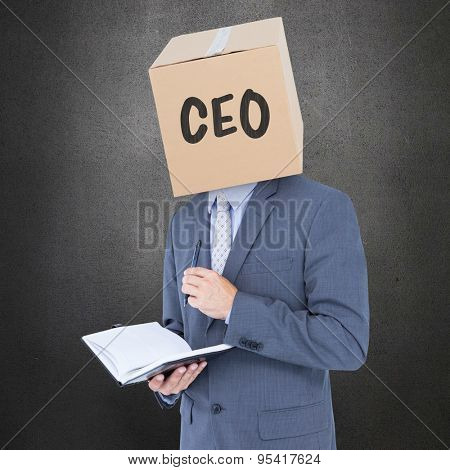 Anonymous businessman with diary against grey room