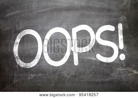 OOPS! written on a chalkboard