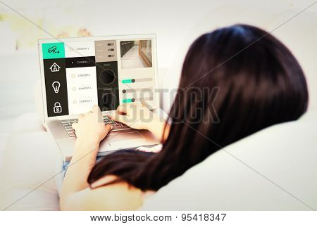 Home automation system against woman using laptop