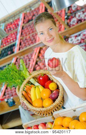 Lady holding apple