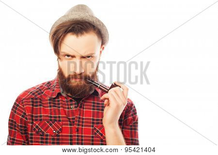 Bearded man in a hat smoking a pipe. Isolated on white.