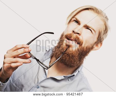 Young bearded hipster man wearing eyeglasses. Over white background.