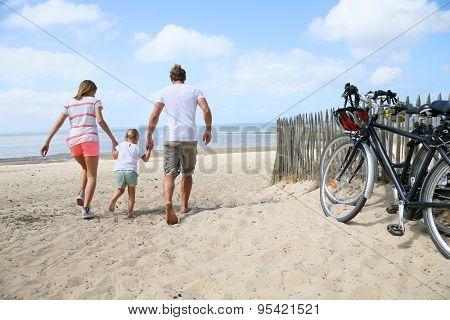 happy family running on a sandy beach