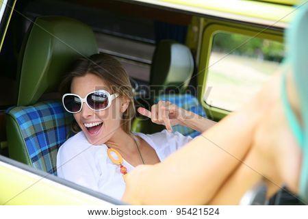 Portrait of hipster girl relaxing in camper van