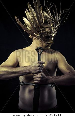Legend, Warrior with helmet and sword with his body painted gold dust