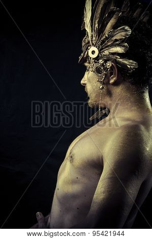 Gladiator, Warrior with helmet and sword with his body painted gold dust