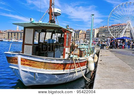 MARSEILLE, FRANCE - MAY 17: Sunday ambiance at the Old Port on May 17, 2015 in Marseille, France. It is a busy port, used as a marina and as a terminal for boat trips, and hosts a fish market