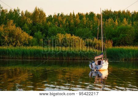 Boat on river with trees on background