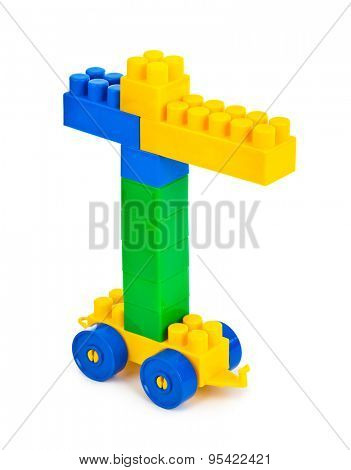 Toy construction hoisting crane isolate on white background
