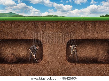Business people dig a tunnel underground
