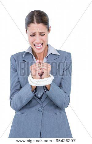 Businesswoman tied up businessman on white background