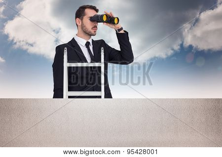 Businessman looking on a ladder against balcony and bright sky