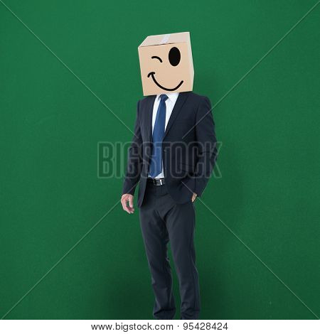 Anonymous businessman against green