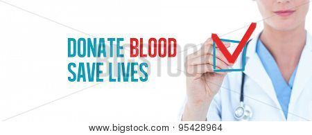 Young doctor writing with marker against donate blood save lives