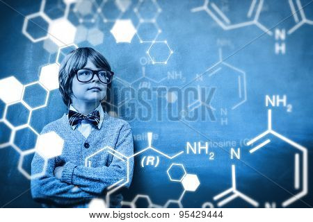 Science graphic against boy with arms crossed looking up at blackboard