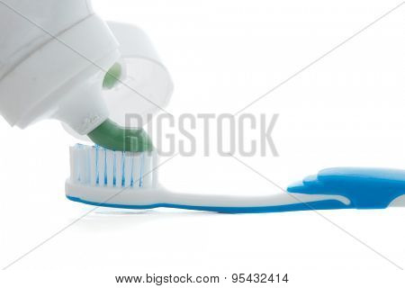 Putting toothpaste on the toothbrush