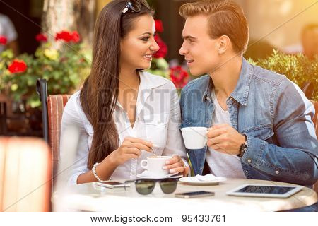couple in cafe enjoying the time spending with each other