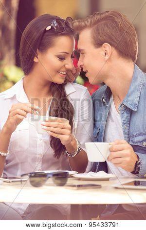 young loving couple having romantic dating at cafe