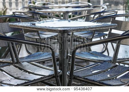 table in a cafe in the rain