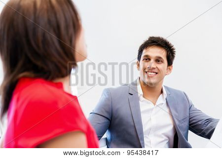 Two young business collegue talking in office