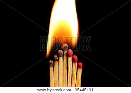 Burning matches on dark background