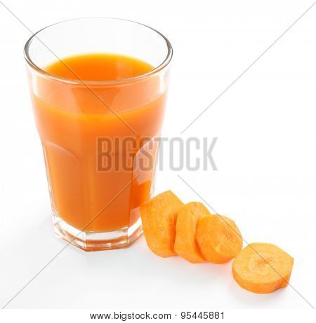 Glass of carrot juice with vegetable slices isolated on white