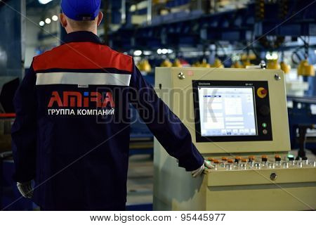 ST. PETERSBURG, RUSSIA - JUNE 30, 2015: Worker at work in the Megapolis plant owned by Amira Group. It's Russia's largest plant producing the lighting poles