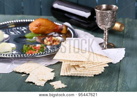 Matzo for Passover with Seder meal and wine on plate on table close up