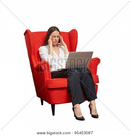 businesswoman with laptop on knees holding hands at temples and remember something. isolated on white background