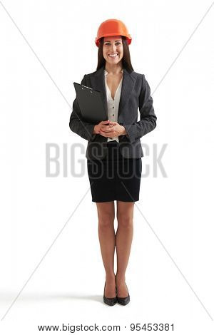 full length  portrait of smiley businesswoman in orange hardhat holding black folder and looking at camera. isolated on white background