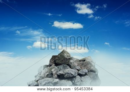 stone crest over blue sky with clouds
