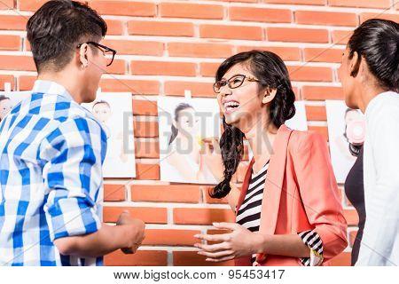 Team in advertising agency choosing pictures of models